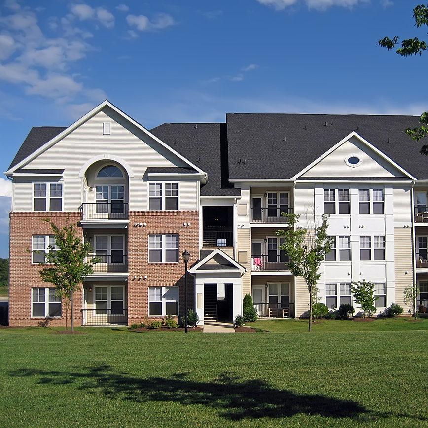 Facade of an upscale suburban apartment building.